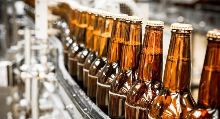 Máy rửa và đóng nắp chai tự động trong máy bán bia